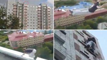 VIDEO DEMENTA TOTALA! Cel mai curajos practicant de parkour! Face tumbe peste cele mai intalte cladiri si poduri din Rusia!