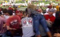 In Romania i s-ar spune Meme :) Femeia turbata care a batut un suporter la oficiala in timpul unui meci de fotbal! Coincidenta: o cheama Michelle :)) VIDEO